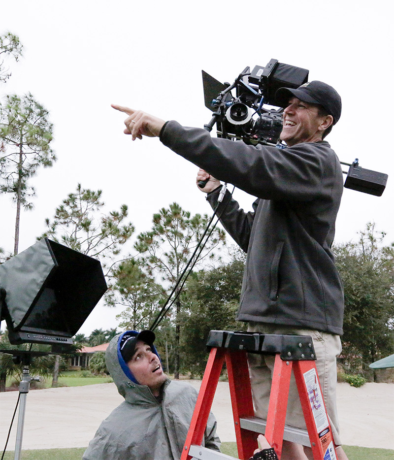 Guy with camera pointing at something