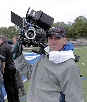 Crew person holding camera
