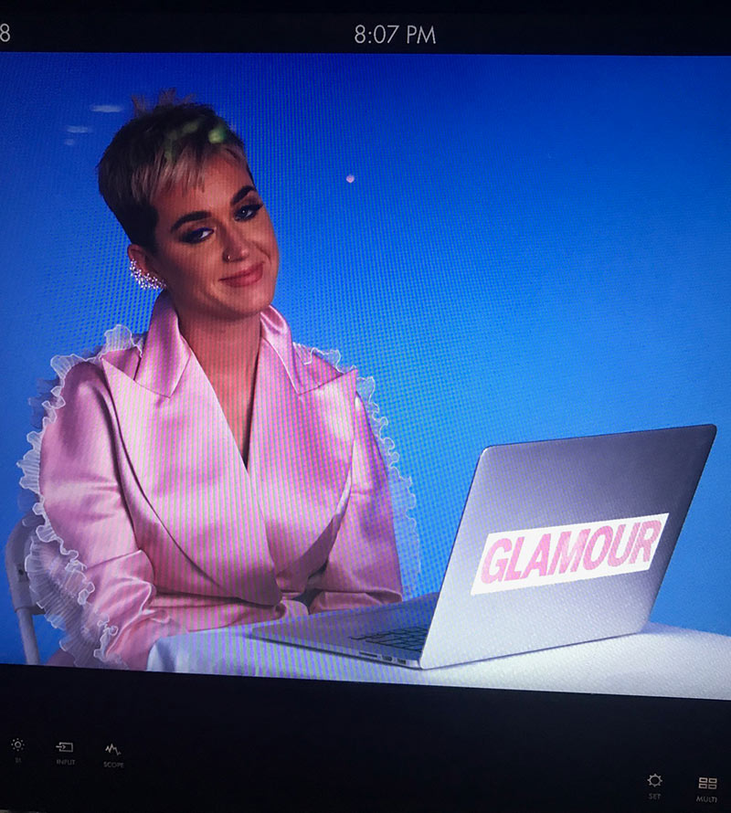 Katy Perry in front of Laptop